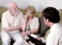 Elderly Couple Receiving Therapy